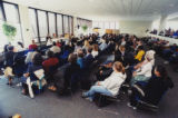 Attendees listening to a speaker at a 9/11 terrorism teach-in, 2001