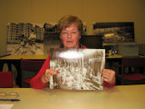 Patricia Willis holding a photograph of her grandfather Patrick Downey at the American Tool Company in Hyde Park,...